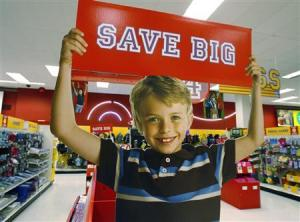 A sign offering big savings in the back to school supply department is pictured at a Target store in Los Angeles, August 18, 2009.  REUTERS/Fred Prouser